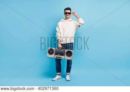 Photo Portrait Full Body View Of Funky Man With Stubble Holding Boombox Isolated On Pastel Blue Colo