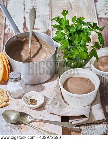 Homemade Cream Soup With Portobello, Porcini Mushroom With Crackers On Wooden Table. Concept Of Heal