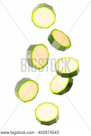 Set Of Flying Fresh Zucchini Slices Isolated On White Background