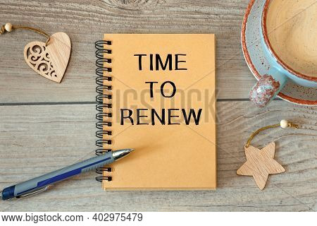 Time To Renew Is Written On A Notepad On An Office Desk With Office Accessories.