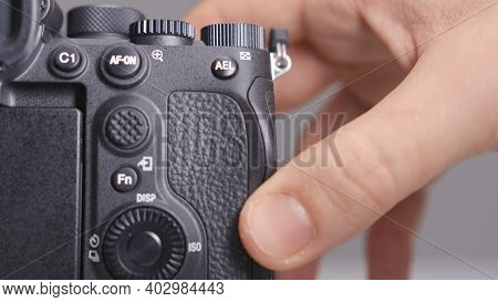 Russia, Moscow-december, 2020: Memory Card In Camera. Action. Close-up Photographer Inserts New Memo