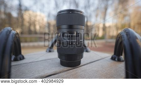 Russia, Moscow-december, 2020: Close-up Of Professional Camera Lens. Action. Lens For Professional C