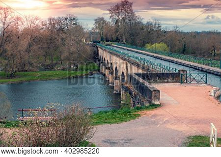 Digoin Canal Bridge. Boat Canal Bridge Over Laura River In Early Spring. Digoin, France