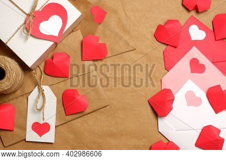 Gifts And Envelopes, Colored And Wrapped In Brown Craft Paper, Tied With Twine With Bows And Labels,