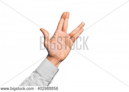 Hand of caucasian young man showing fingers over isolated white background greeting doing Vulcan salute, showing hand palm and fingers