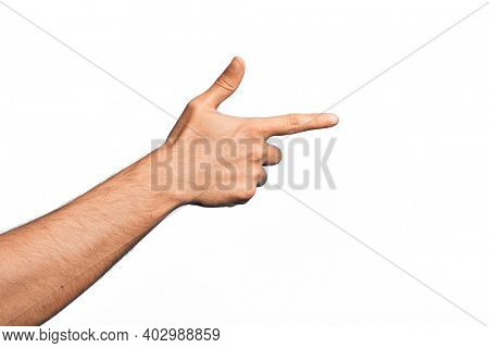Hand of caucasian young man showing fingers over isolated white background pointing with index finger to the side, suggesting and selecting a choice