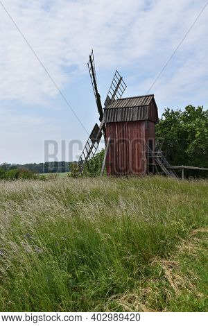 Green Landscape With An Old Wooden Windmill On The Island Oland In Sweden