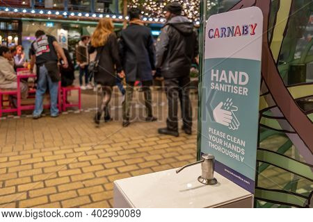 London, Uk - November 1, 2020: A Hand Sanitiser Station In Carnaby, London, With A Message Asking Pe