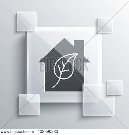 Grey Eco Friendly House Icon Isolated On Grey Background. Eco House With Leaf. Square Glass Panels.