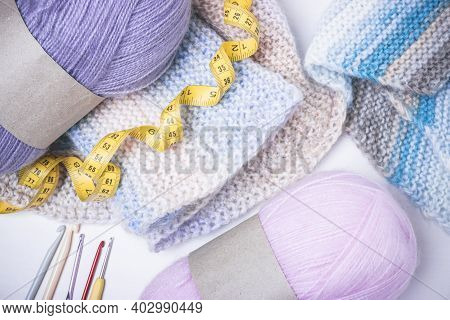 Knitting At Your Leisure. Crochet Hooks, Yellow Centimeter And Inch Tape Tailor. Knitting Pattern. T