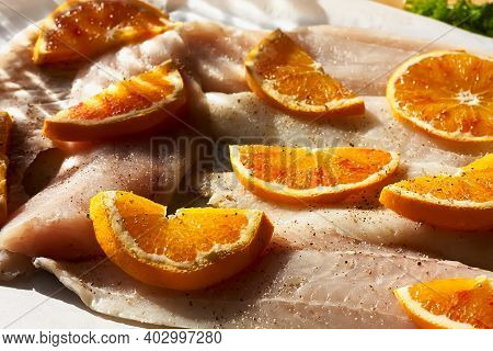 Cod Fish Fillet With Oranges On Baking Paper. Seafood, Healthy Eating. Natural Light.