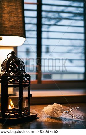 Cozy Home Lantern With Burning Candle Light Decor On Wooden Windowsill With Fragile Glass Christmas