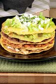 This delicious mexican dish is prepared with crunchy corn tostadas prime beef beans and guacamole poster