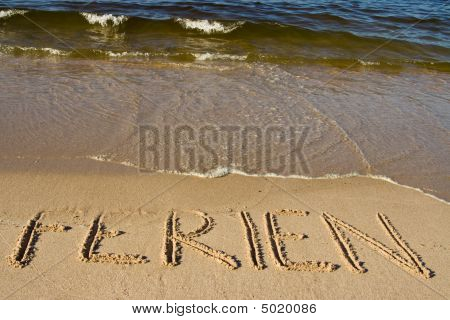 vacation written on a beach in German poster