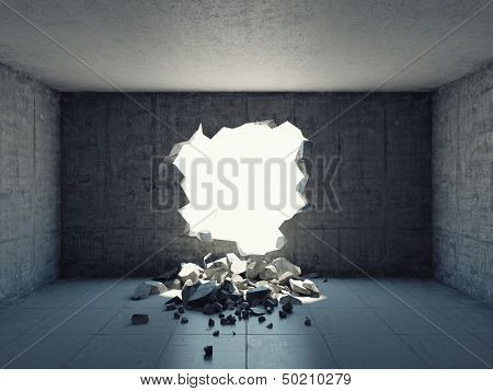 Destroyed wall of concrete structure. Concept of escape to freedom.