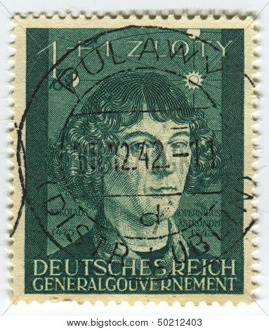 DEUTSCHES REICH  - CIRCA 1943: A stamp printed in Deutsches Reich shows image of the Nicolaus Copernicus was a Renaissance mathematician and astronomer who formulated a heliocentric model, circa 1943.