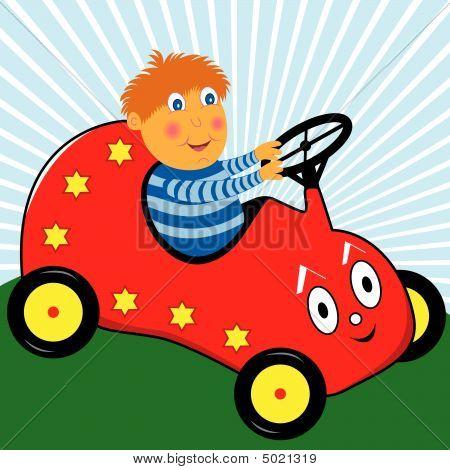 Menino dirigindo o carro do brinquedo Pedal