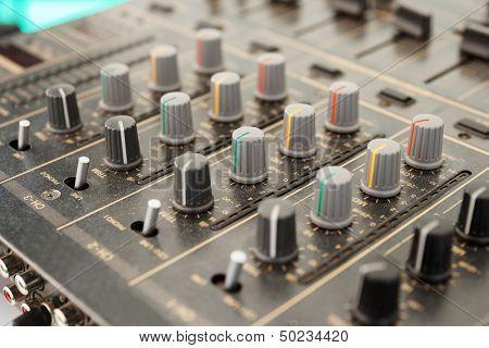 Sound mixer, close-up, selective focus
