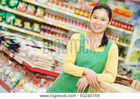 chinese young woman choosing food tea during shopping at china supermarket