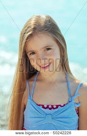 Beautiful Little Girl Near The Sea