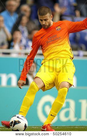 BARCELONA - MAY, 26: Gerard Pique of FC Barcelona during the Spanish League match between Espanyol and FC Barcelona at the Estadi Cornella on May 26, 2013 in Barcelona, Spain