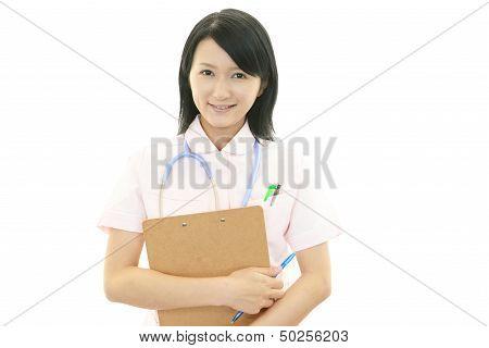 Smiling Asian female nurse