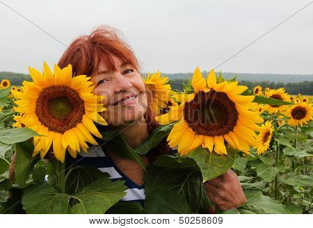 Smiling woman in a sunflower field