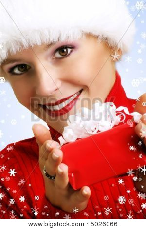 Portrait Of A  Woman With A Gift In Her Hands And Snowflakes