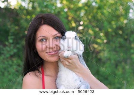 Young Smiling Woman And Rabbit