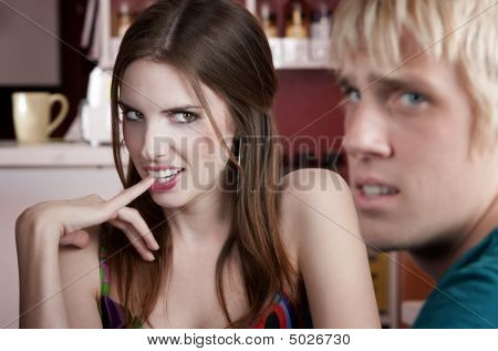 Woman Flirting With Uninterested Male Friend