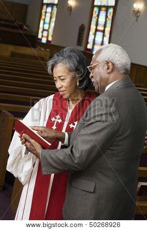 Female Reverend talking to parishioner