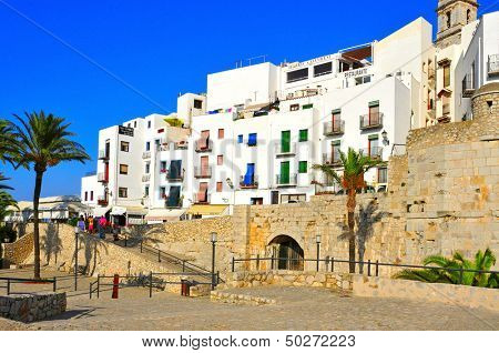 PENISCOLA, SPAIN - JULY 26: Tourists around the old town on July 26, 2013 in Peniscola, Spain. The town is a typical summer destination in the North of the Valencian Community