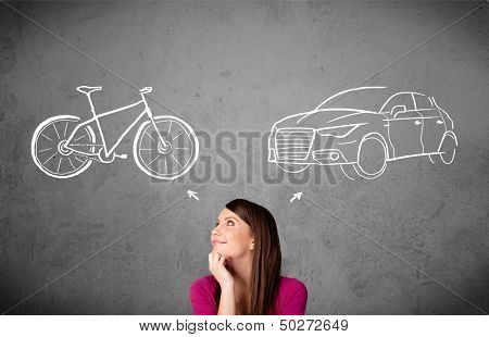 Pretty young woman taking a decision between bicycle and car