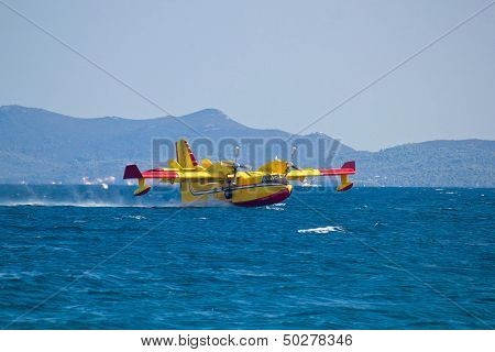 Firefighting Airplane Taking Water From Sea