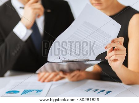 business, office, law and legal concept - picture of man and woman hand signing contract paper poster