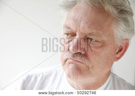 unhappy senior man