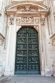 Decorated doors of Milan Cathedral (Duomo di Milano 1386-1965). Milan Italy poster