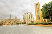 A view of the clock tower in Nejme Square in Beirut Lebanon some local architecture of downtown Beirut the Mohammad Al-Amin mosque and Greek orthodox church of St George. poster