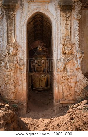 Buddha image inside of ancient Burmese Buddhist pagodas Nyaung Ohak in the village of Indein on Inlay Lake in Shan State Myanmar (Burma). poster
