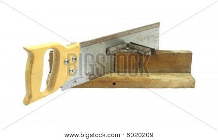Old miter box with saw