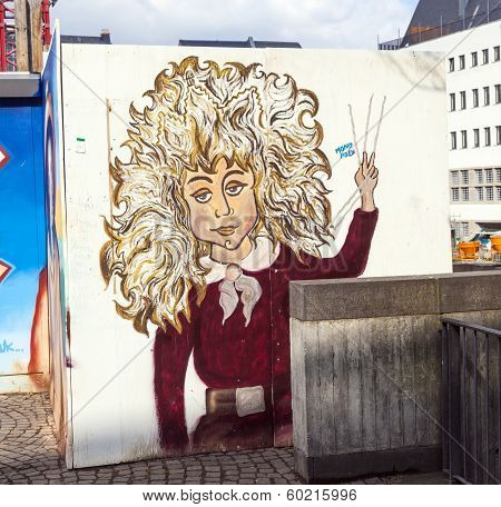 Struwwelpeter Painting At A Wall