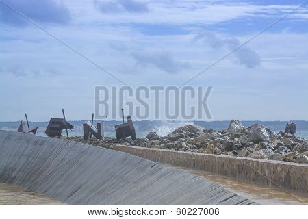Pier With Sculpture And Wood Structure