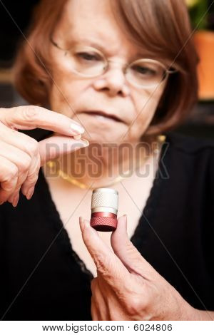 Woman With Small Pill And Case