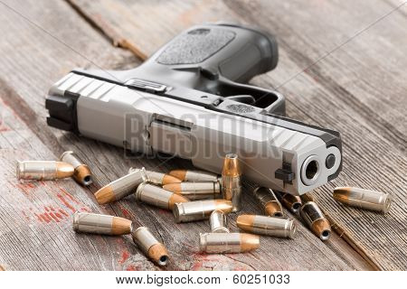 Handgun With Scattered Bullets And Cartridges
