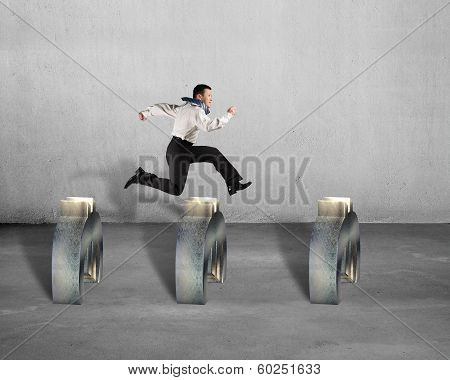 man jumping Over Euro Obstacles