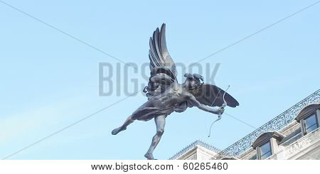 Piccadilly Circus with statue of Anteros aka Eros in London UK poster