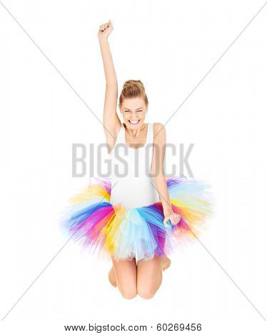 A picture of a happy ballerina jumping in a colorful skirt over white background