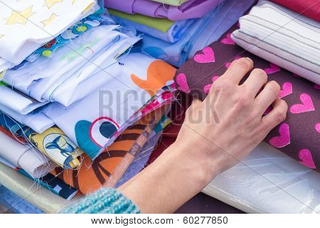 Fabrics On A Market Stall