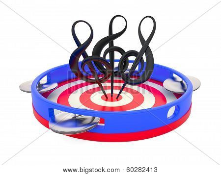 Treble clefs on tambourine