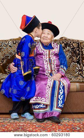 Grandson Kisses His Great Grandmother